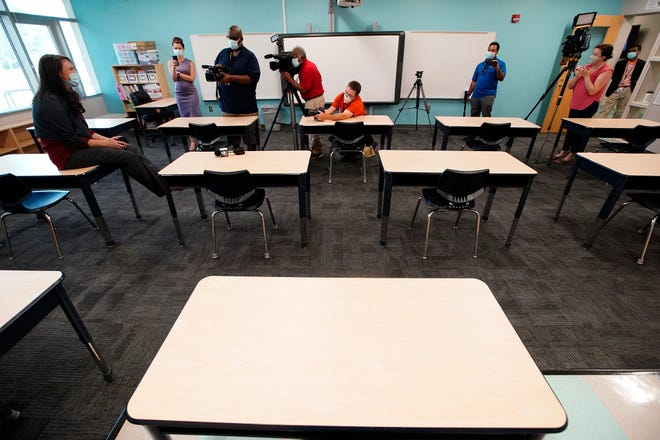 Principal Susan Stevens talks to the media during a demonstration of a socially-distanced classroom at A.J. Whittenberg Elementary School on July 20 in Greenville.