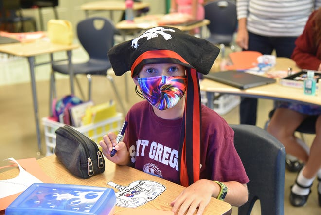 Third-grade student Lawson Adams is hard at work during Talk Like a Pirate Day at St. Gregory the Great Catholic School.