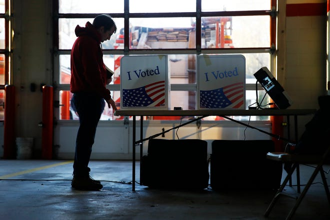 A voter casts a ballot in the South Carolina primary election Feb. 29 in Columbia.