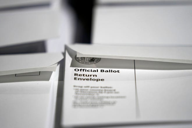 On Sept. 3, 2020, stacks of ballot envelopes waiting to be mailed are seen at the Wake County Board of Elections in Raleigh, N.C. Data obtained by The Associated Press shows Postal Service districts across the nation are missing the agency's own standards for on-time delivery as millions of Americans prepare to vote by mail.