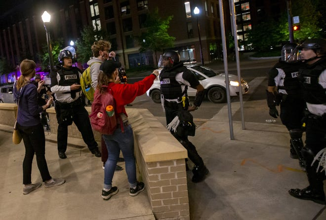 Columbus police threaten to arrest journalists from The Lantern, Ohio State's student newspaper, for breaking curfew following a peaceful protest for George Floyd that ended near campus on June 1. The students were forced to leave after being sprayed with pepper spray. [Adam Cairns/Dispatch]