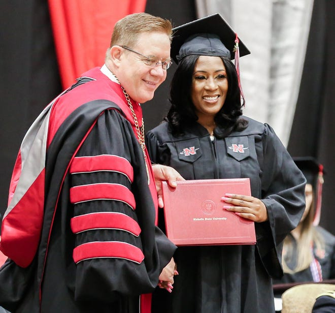 Ashley Landry of Napoleonville receives her diploma from Nicholls State President Jay Clune during the Thibodaux university's fall commencement Dec. 14 in Stopher Gym.