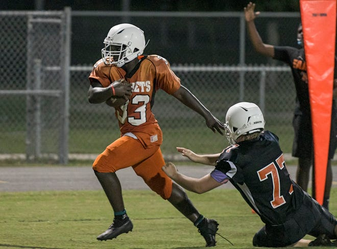 Leesburg's Eric Coffie (33) scores during last week's Orange-and-Black game at Leesburg High School. The Yellow Jackets travel to South Lake for Friday's season opener. [PAUL RYAN / CORRESPONDENT]