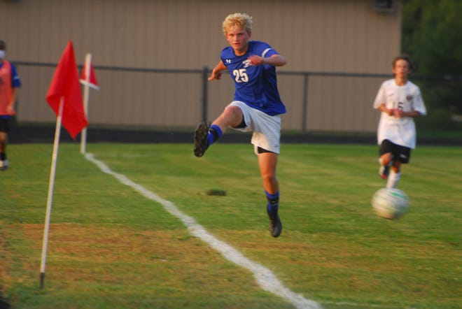 Drew Yanico (25) keeps the ball in play for the Bobcats during Thursday evening soccer action.