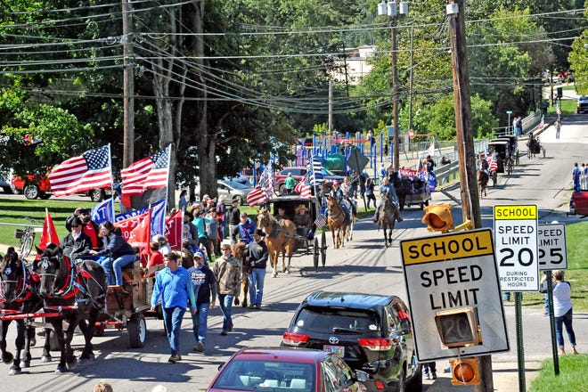 The pro-Trump parade arrived in Fredericksburg after traveling several miles Sept. 19. A crowd of about 500 people waited to see it.