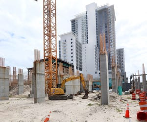 Construction continues on the $192 million Protogroup hotel-condominium project in Daytona Beach. While there has been progress on the South Tower (in  the background), work on the North Tower site has been stopped for over a year.