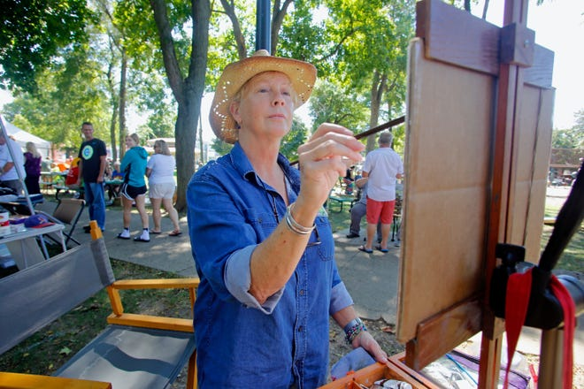 Gin Lammert paints a landscape on her easel Sept. 18, 2016, during the annual Art in Central Park event that allows the public to enjoy art in Fort Madison's historic Central Park. Art in Central Park is 10 a.m. to 4 p.m. today in Fort Madison's Central Park, with artists, music, and food.