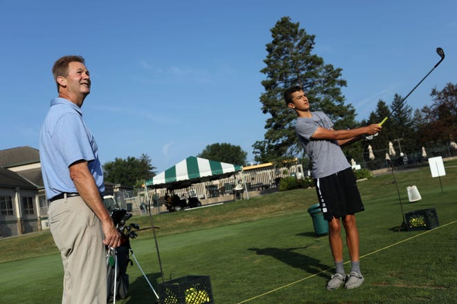 In this file photo Joe Butler, the PGA Head Golf Professional at the Burlington Golf Club, works with Mateo Rascon, Wednesday July 24, 2019 at the Burlington facility. Butler was named Iowa PGA Golf Professional of the Year.