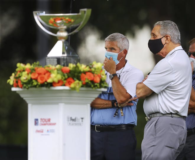 PGA Tour commissioner Jay Monahan (left and Atlanta Falcons owner Arthur Blank prepare to welcome players on the first tee of the East Lake Golf Club in Atlanta Sept. 4 in the Tour Championship. The Blank Family Foundation and PGA Tour Superstores made a $9.5 million grant to The First Tee.