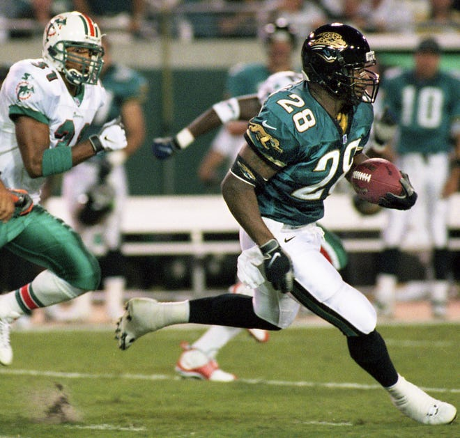 Jaguars running back Fred Taylor (28) breaks clear for a first-quarter touchdown against the Dolphins on Monday Night Football in 1998, the teams' first-ever meeting.