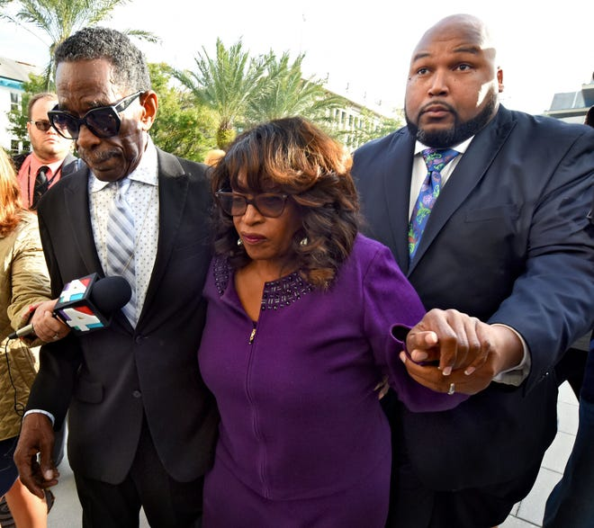 Former U.S. Rep. Corrine Brown walks toward Jacksonville's federal court in this 2017 photo before her sentencing on fraud and tax charges.