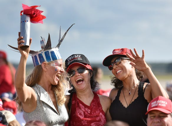 Melissa Wrenn (from left), Alisha Mishell and Jenna Delta of Gainesville, Florida dance to piped in music as they wait with other supporters for President Donald Trump to arrive Thursday, September 24, 2020 at the Great American Comeback Event at the Cecil Commerce Center in Jacksonville, Florida. (Will Dickey/Florida Times-Union)