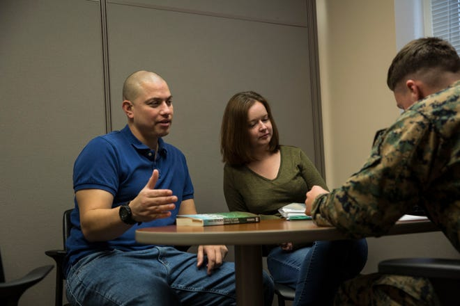 A military couple begin the process of filing their taxes with help from a Marine at the tax center on Marine Corps Base Camp Lejeune, Feb. 13, 2018.