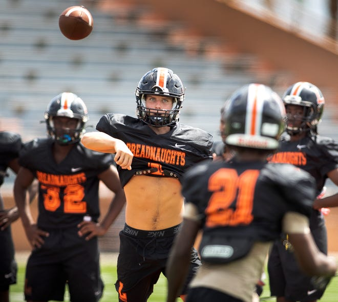Lakeland High School quarterback Mason Martin throws a pass during practice as he prepares to lead the Dreadnaughts in the long-delayed season opener against Lake Gibson.