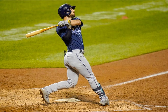 Tampa Bay Rays' Brandon Lowe follows through on a two-run home run during the eighth inning against the New York Mets on Wednesday in New York.