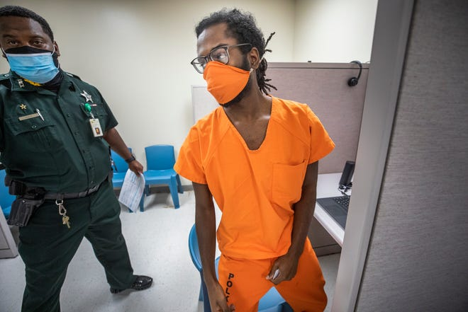 "Murder defendant Jacarie Moore turns to leave after a teleconference first appearance hearing at the South County Jail in Frostproof on Thursday. Moore is charged with the murder of Jeannairy ""Jeannie"" Dominguez, who had been romantically involved with Moore and was gunned down on July 19 at her Lakeland home."