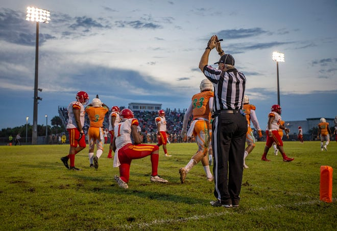 In this 2019 photo, a referee signals a safety after the Atlantic defense sacked Deerfield Beach quarterback Derohn King (1) in the end zone. Atlantic and Deerfield Beach will both not participate in the FHSAA postseason this fall.