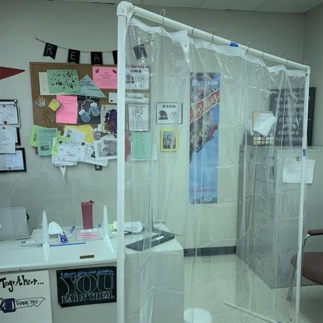 Olympic Heights High School teacher Dana Asen assembled a series of partitions around her desk with plexiglass, PVC pipes and a plastic sheet. [Photo courtesy of Dana Asen]