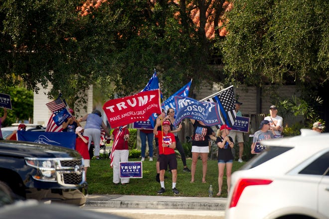 Supporters of President Donald Trump gather at the intersection of PGA Boulevard and Military Trail in Palm Beach Gardens on during a Friday, Sept. 18 rally organized by longtime Palm Beach Gardens resident Willy Guardiola.
