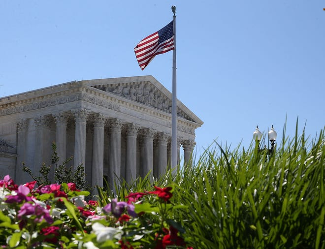 An American flag flies over the U.S. Supreme Court in Washington. Will judges decide who wins the November presidential election?