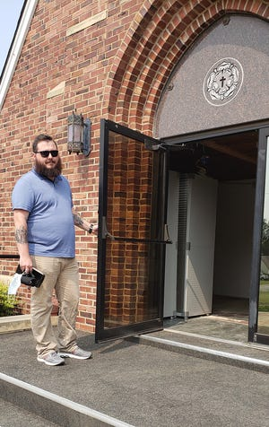 The Rev. Dan Chrismer, pastor of Ascension Lutheran Church, stands ready to welcome members and guests to services at the congregation's new place of worship, formerly Our Saviour Lutheran Church, at East Second Street and South Thompson which was recently donation to Ascension Lutheran by St. Paul's  Luthern Church in Natrona.
