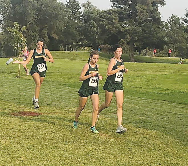 Pratt High School girls cross country runners (from left) Jenna Haas (so), Grace May (fr) and Allie Hoeme(fr) contributed points to the team total at Chaparral last Thursday.