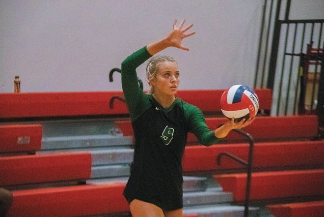 Brayten Ashman gets ready to serve for the Hawks on Tuesday, Sept. 22.