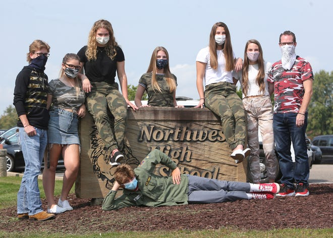 Northwest High School is hosting a spirit week as part of its homecoming festivities with students dressing up in camouflage Thursday. Northwest, along with nearly all other Stark County schools have canceled their homecoming dances due to COVID-19. From left are: Noah Lovett, London Myers, Caroline Kuhn, Leeann Dolensky, Gianna Kuhn, Ashley Cudnik and teacher Rick Woods. Laying down in front is Jake Metzger.