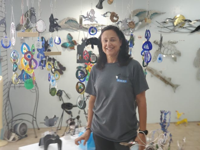 Linda LaCerva, co-owner of Metalartz Gallery on Hypolita Street, says business at her decorative arts and gift shop in St. Augustine is down by about half year over year from 2019.