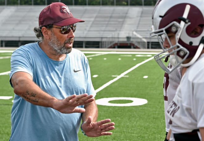 Riverview Rams offensive coordinator and former NFL head coach Todd Haley works with the Rams' offense during Wednesday's practice in Sarasota.