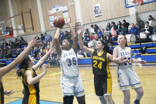Ashija Garner of Mount Shasta High School, center, has joined the College of the Siskiyous women's basketball team.