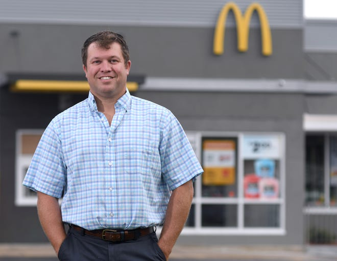 David Anderson, stands in front of the McDonald's along Military Cutoff Rd. in Wilmington N.C., Friday, August 21, 2020. Anderson is the owner and operator of 24 McDonald's and is one of the 40 Under 40 honorees for 2020.