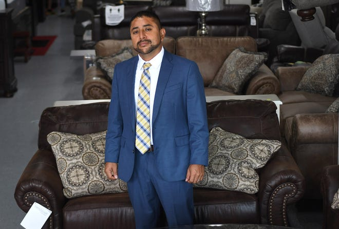 Gustavo Rodea, owner of Mattress and Furniture Liquidators and Rodea's Enterprise Inc. stands in his business in Wilmington, N.C., Wednesday, Aug. 19, 2020. Rodea is one of the 40 Under 40 honorees for 2020. [MATT BORN/STARNEWS]