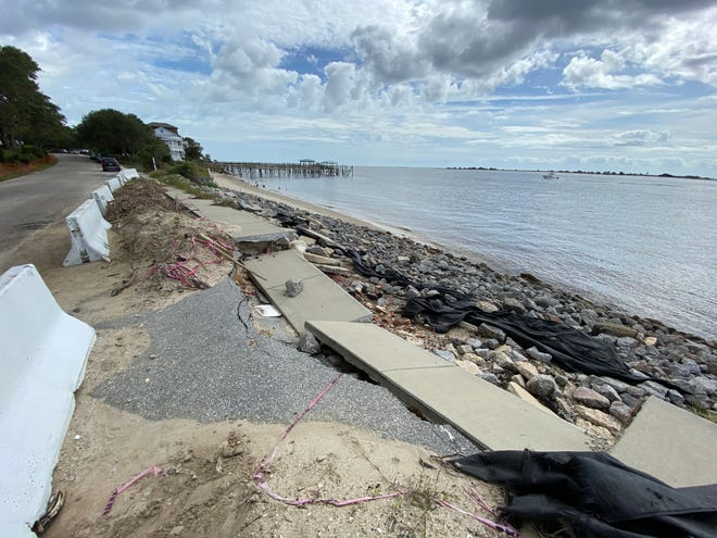 The sidewalk along East Bay Street in Southport is still in shambles after Hurricane Isaias' storm surge dug out the sand, dirt and rock from underneath it in August 2020. [HUNTER INGRAM/STARNEWS]