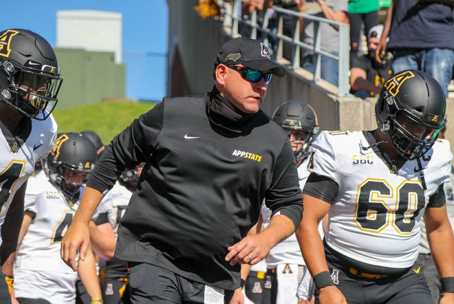 Sep 19, 2020; Huntington, West Virginia, USA; Appalachian State Mountaineers head coach Shawn Clark leads his team onto the field before their game against the Marshall Thundering Herd at Joan C. Edwards Stadium.