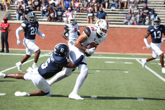 Former Pine Forest quarterback Julian Hill (85) fights for yardage after a catch for Campbell against Georgia Southern on Sept. 12. (Photo courtesy of Campbell University athletics)