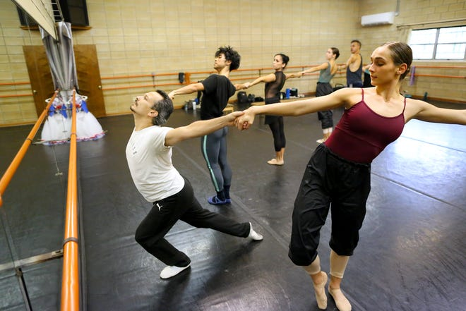 "Dancers with the Dance Alive National Ballet, including Andre Valladon, left, practice Wednesday for their upcoming performance entitled ""Meet the Dancers,"" scheduled to be on the rooftop of the Holiday Inn University Center at 6:30 p.m. Friday."