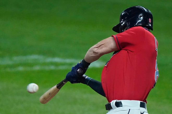 Cleveland Indians' Jordan Luplow hits a solo home run in the ninth inning of a baseball game against the Chicago White Sox, Wednesday, Sept. 23, 2020, in Cleveland. (AP Photo/Tony Dejak)