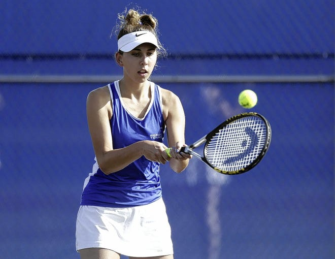 Ready's Jenna Ruth hits a backhand return during a match against Grove City on Sept. 21. Ruth is one of six seniors leading the way for the Silver Knights, who were 5-7 overall before facing Hilliard Darby on Sept. 24.