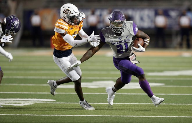ACU running back Jermiah Dobbins (21) tries to elude a UTEP defender. The Miners beat ACU 17-13 in the Wildcats' season opener last year at the Sun Bowl in El Paso.