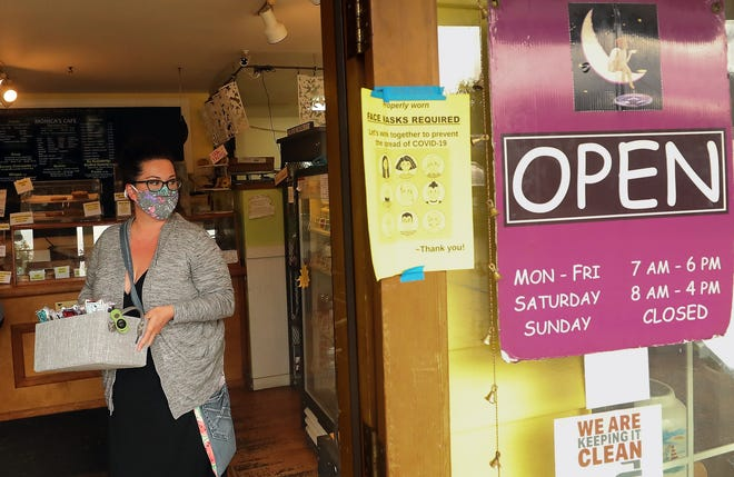 Rachel Finn drops off a box of face coverings at Monica's Waterfront Bakery & Cafe in Old Town Silverdale on Thursday. Finn has been sewing cloth masks since the pandemic started and has made over 10,000.