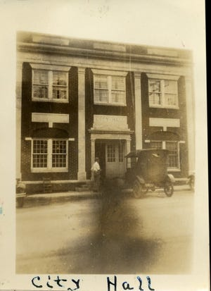 Black Mountain's City Hall building looked much the same on April 12, 1927, as it does today. But what is that dark shadow in the foreground? Could it be a Swannanoa Valley spirit, haunting the streets of Black Mountain?