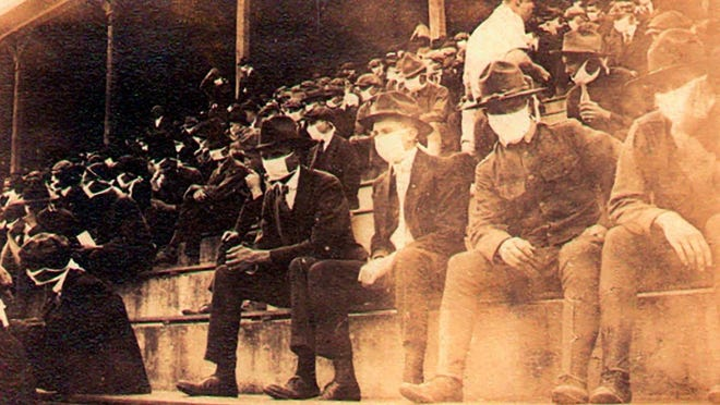 Photo of the crowd at an undetermined 1918 Georgia Tech home football game as taken by Thomas Carter. Almost everyone in the crowd is wearing face masks due to the Spanish flu pandemic. The photo is still on display at the home of Carter's great-grandson, Andy McNeil.