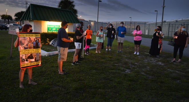 A dozen people showed up at the Brevard County Detention Center in Sharpes for the Peace Keepers of Brevard candlelight vigil for Gregory Edwards.