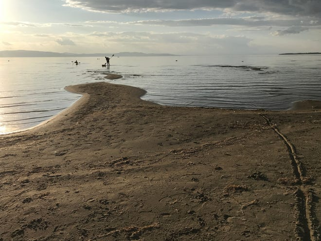 Paddlers launch in shallow water along Harbor Watch Beach in Burlington on Sept. 23, 2020.