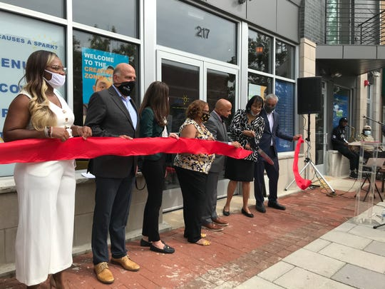 IDEA Center founder Cynthia Primas (second from right) cuts the ribbon on its new Market Street location.