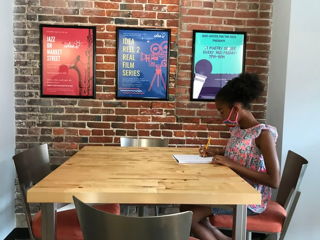 London Daniels, age 10, sketches at a desk at the IDEA Center in Camden.
