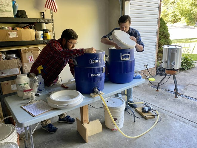 Seth Blewitt and Justin Park work on their home brew inside Blewitt's garage in Chillicothe, Ohio. The duo spends every Saturday morning creating new recipes together. And later this year, they'll open Old Capitol Brewing together in downtown Chillicothe.