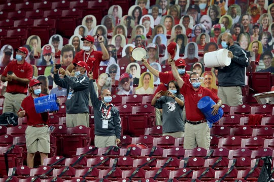 The Cincinnati Reds ground crew is recognized for their work over the course of the season in the fifth inning of a baseball game between the Milwaukee Brewers and Cincinnati Reds, Wednesday, Sept. 23, 2020, at Great American Ball Park in Cincinnati.