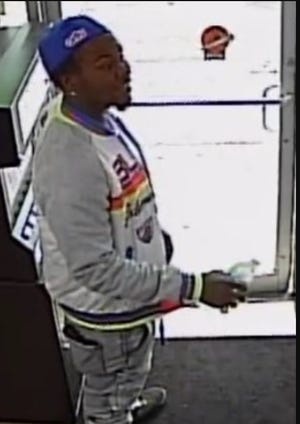 Police say the man walked into the gas station and fire two pistols at several people before fleeing the scene in a four-door BMW with tinted windows.